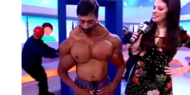 Bodybuilder during a TV show. Image courtesy Daily mail. www.dailymail.co.uk